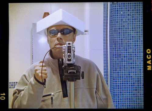 reflected self-portrait with Bencini Comet III and polystyrene hat by pho-Tony
