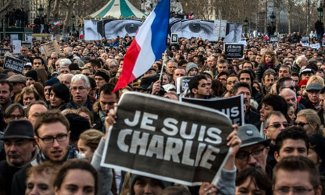 Demonstrators make their way along Place de la Republique.