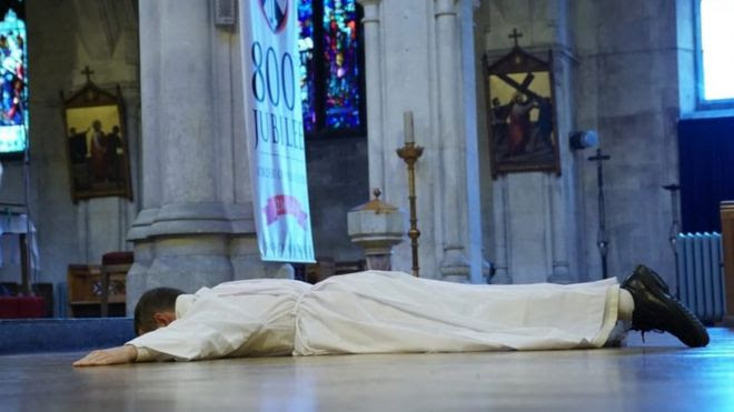 Brother Philip Mulryne lies prostrate at the ordination service in Dublin, 29 October 2016