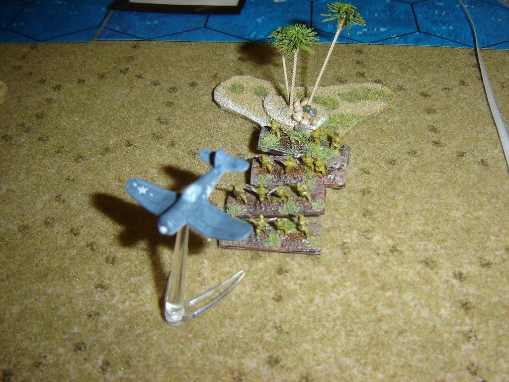 Corsair strafes Japanese infantry in jungle