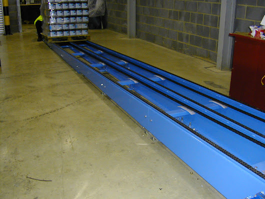 Chain conveyors - Ideal for handling those problem loads - Andrews Automation