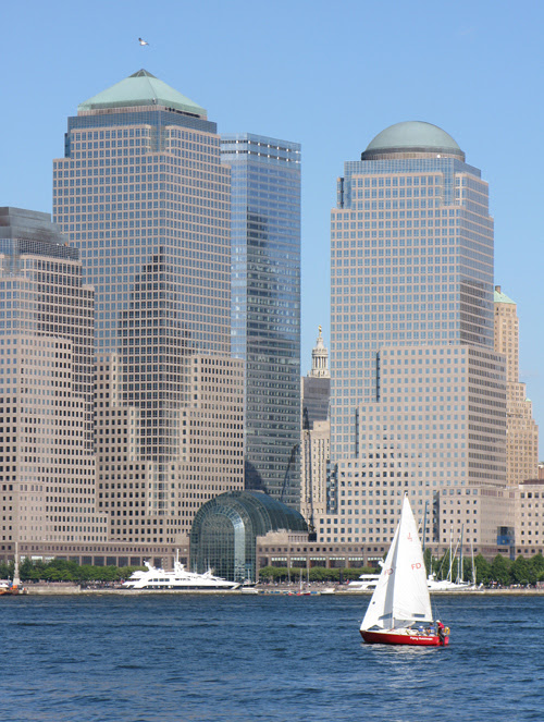 a red sailboat on the Hudson River near the World Trade Center site, Manhattan, NYC