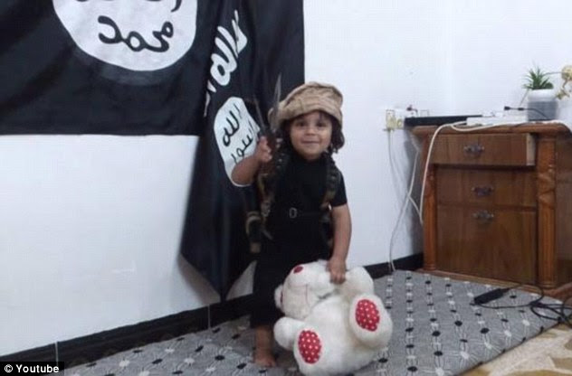 Innocence lost: ISIS is believed to have released a disturbing new propaganda video which appears to show a young child beheading a teddy bear
