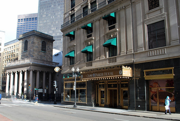 The Tremont Street Entrance to Boston's Omni Parker House with King's Chapel in the background.