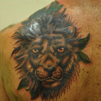 Lion Head Tattoo On Left Shoulder Blade