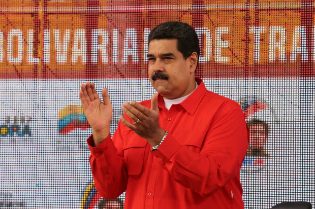 Venezuela's President Nicolas Maduro applauds as he attends a pro-government rally with workers in Caracas, Venezuela March 18, 2017. Miraflores Palace/Handout via REUTERS ATTENTION EDITORS - THIS PICTURE WAS PROVIDED BY A THIRD PARTY. EDITORIAL USE ONLY. ORG XMIT: MIR101