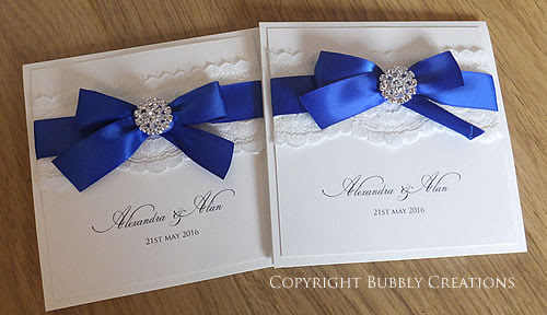 Glamour Wedding Invitations in Royal Blue - Lace and Diamante with a satin bow