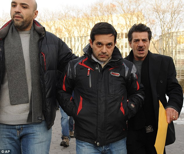 Gangster: Reputed Colombo family member Angelo Spata, centre, leaves Brooklyn federal court on bail