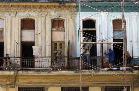 Laborers work on a building in Havana's old quarters.