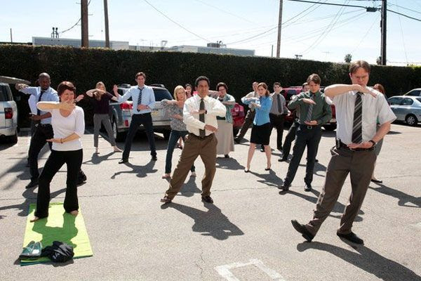 The employees of Dunder Mifflin do a morning workout session during the series finale of THE OFFICE.