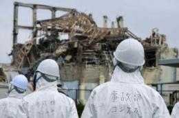 Members of government panel are seen here inspecting damaged building at the Fukushima Dai-ichi nuclear power plant