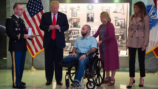Trump awards Purple Heart during first visit to Walter Reed
