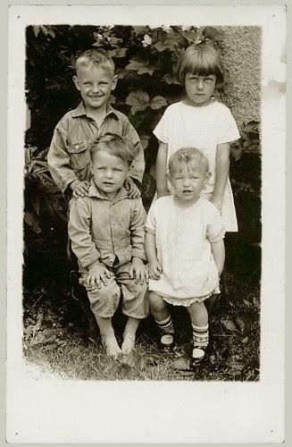 Four children, one of them happy.