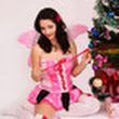 Beautiful girl with gift boxes in pink fairy costume smiling