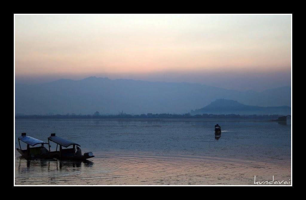 Boats at Dal lake during sunset