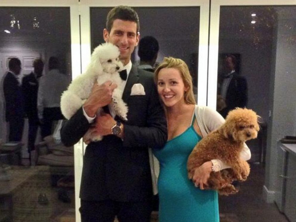 PHOTO: Novak Djokovic and Jelena Ristic are pictured in a photo posted to Djokovics Twitter account on July 6, 2014 with the note, My precious little family :).