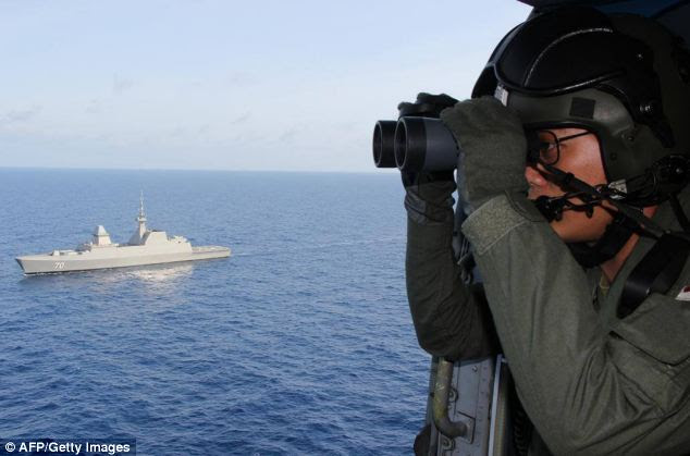 Republic of Singapore Navy (RSN) personnel participating in the search and rescue operations, approximately 380 nautical miles (700 kms) north of Singapore, in the South China Sea