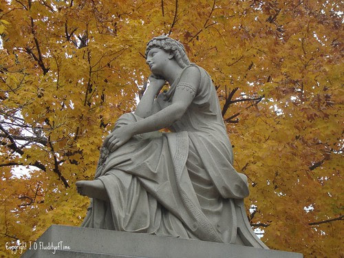 seated figure yellow leaves1
