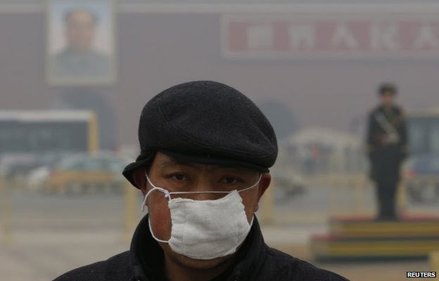 Man in pollution mask in Tiananmen Square, Beijing (Jan 2015)
