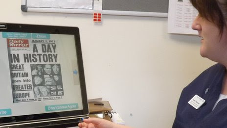 Helen Robinson demonstrates software used in dementia therapy at James Cook Hospital