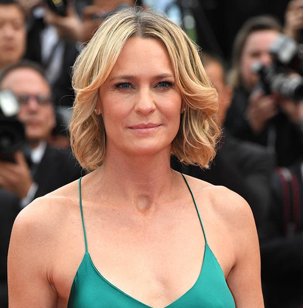 Braless Robin Wright glows in green at Cannes Film
