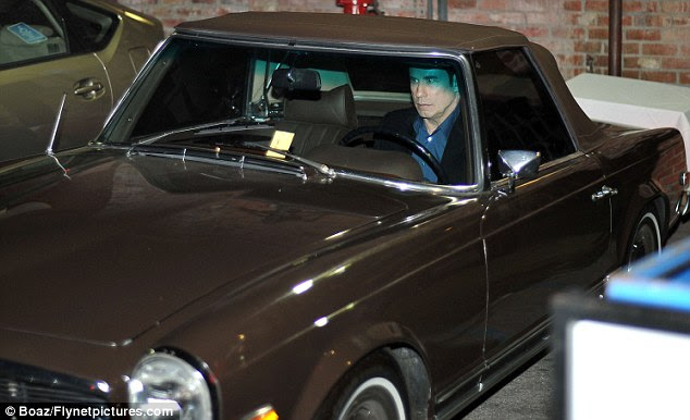 It's a classic: Travolta leaves the restaurant in his vintage car