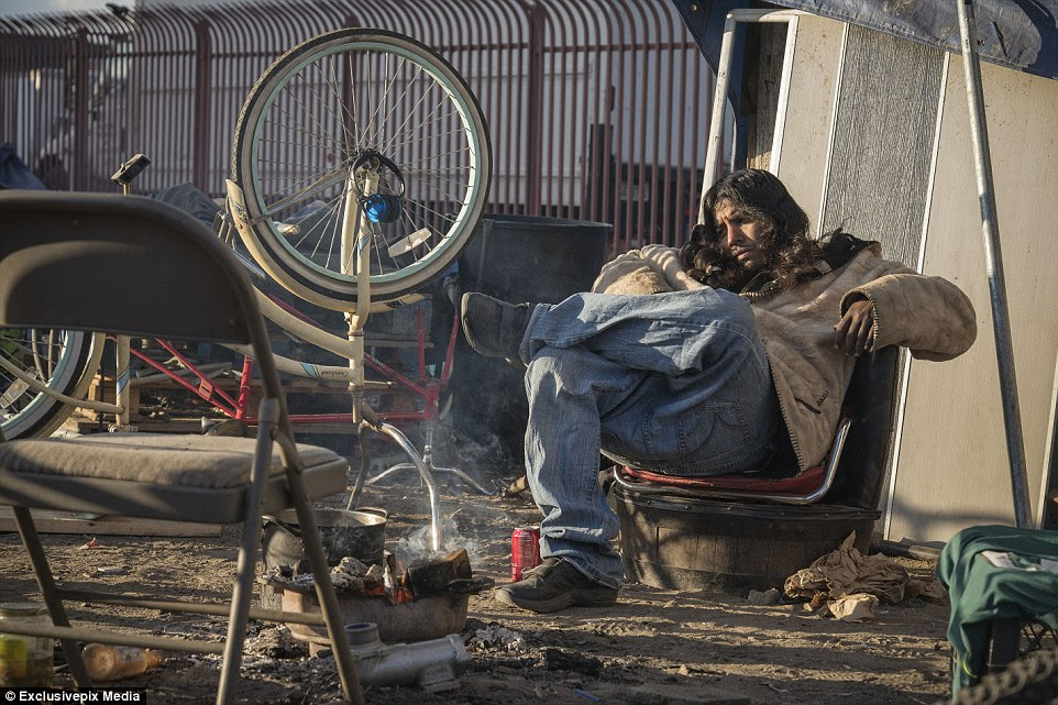 This man is one of several people who has made his home underneath the rail tracks at Washington Street and the L.A. River