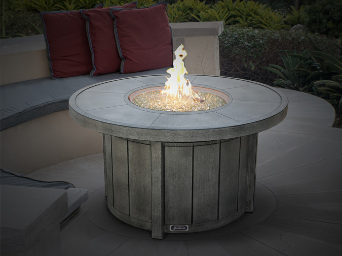 Huntington round Fire table with concrete grey finish | Ogni