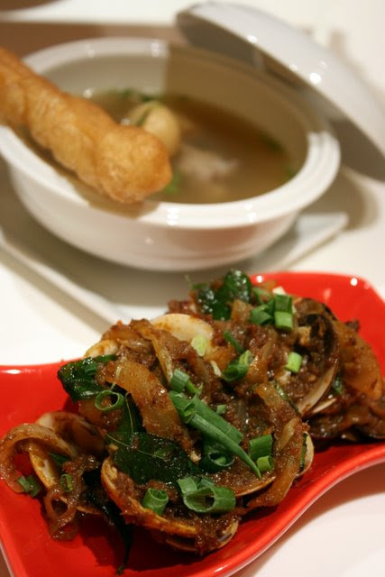 Wok-fried Clams with Sambal Chili Sauce (front), and bowl of bak kut teh (back)