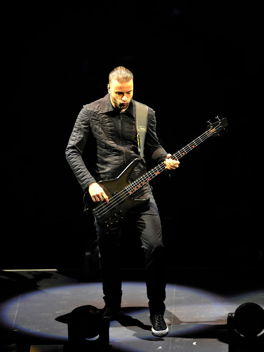Bassist Christopher Wolstenholme of Muse performs at
