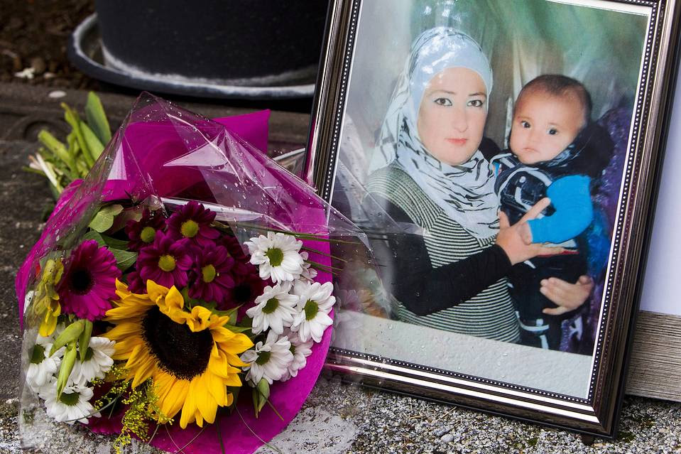 A photograph of Syrian woman Rehan Kurdi holding her son Aylan is pictured next to a bouquet of flowers outside the home of Rehan's sister-in-law Tima Kurdi in Coquitlam, British Columbia September 3, 2015.
