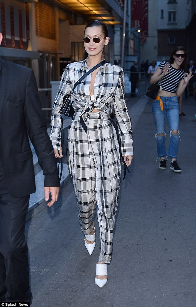 Looking good: Bella opted for high-waisted trousers and a crop top as she headed out