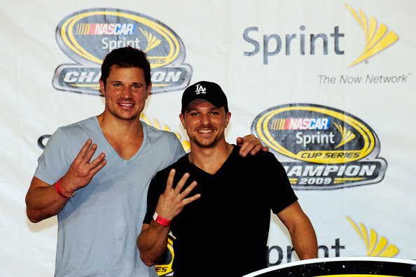 (L-R) Brothers Nick Lachey and Drew Lachey pose on the stage after the NASCAR Sprint Cup Series Ford 400 at Homestead-Miami Speedway on November 22, 2009 in Homestead, Florida.