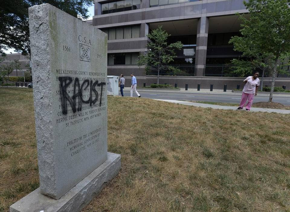 """The word """"racist"""" has been painted on a Confederate monument that sits across from the Charlotte Mecklenburg Police Department outside the Old City Hall, Wednesday, July 15, 2015."""