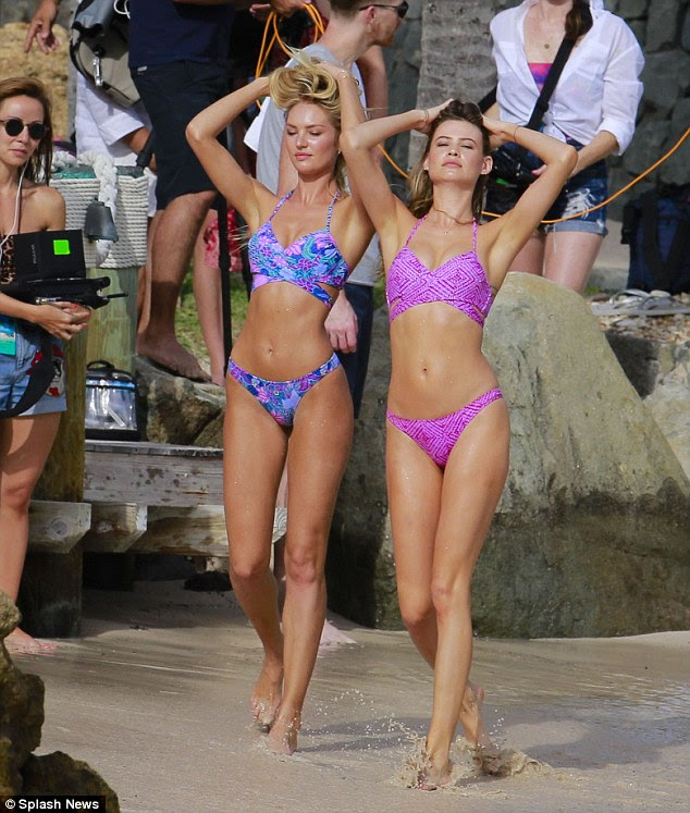 Double trouble! Candice and Behati Prinsloo, 26, teamed up for a few snapshots displaying matching bikinis in different patterns showing off their sculpted abs