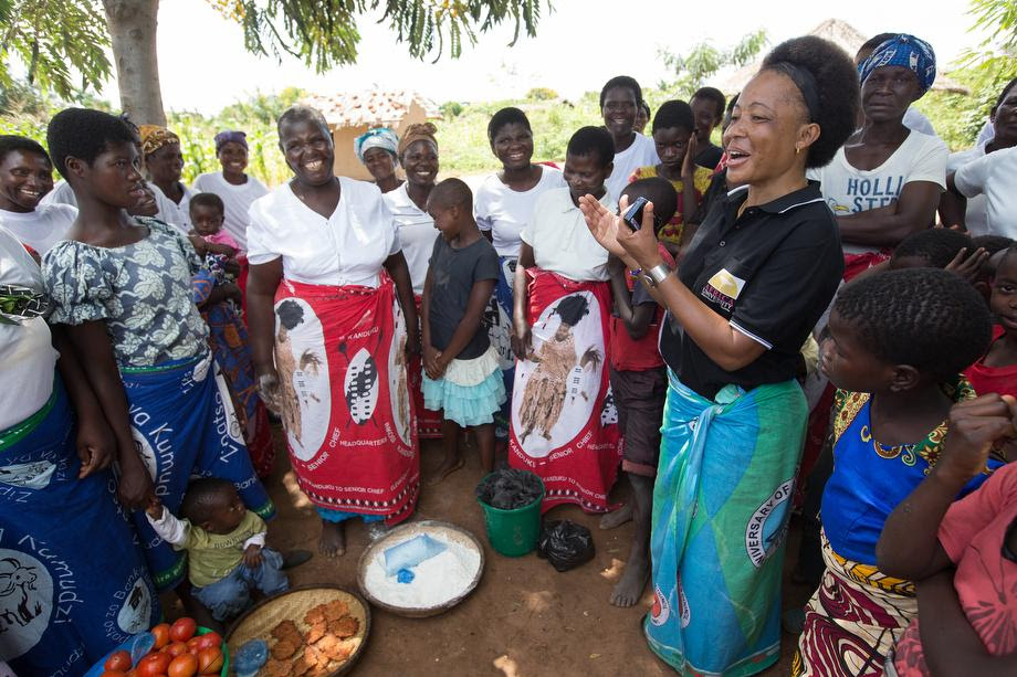 """Mercy Chikhosi (in black shirt) regularly visits with the women of Nkhafi village in Malawi. She has an easy rapport with members of the village. """"I developed a strong bond and a relationship so I continue visiting, influencing and motivating them to identify their needs and find solutions with local resources,"""" Chikhosi said. Photo by Mike DuBose, UMNS."""