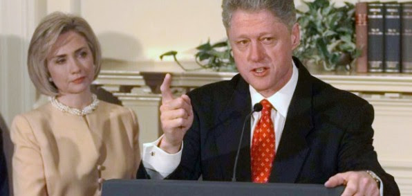 Hillary Clinton watches as President Clinton discusses the Monica Lewinsky scandal at the White House in January 1998.