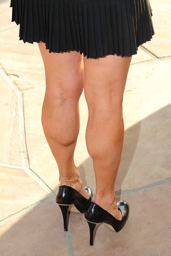 muscular calves and high heels