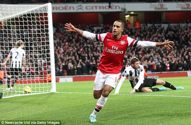 Middle man: Theo Walcott scored a brilliant hat-trick as Arsenal thumped seven past a hapless Newcastle