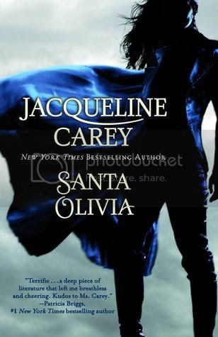 cover art for Santa Olivia, featuring a woman in silhouette. She wears a long blue coat blowing to her right side in the breeze.