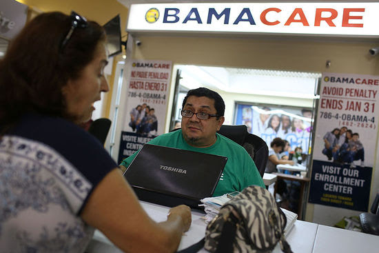 MIAMI, FL - NOVEMBER 02:  Martha Lucia (L)  sits with Rudy Figueroa, an insurance agent from Sunshine Life and Health Advisors, as she picks an insurance plan available in the third year of the Affordable Care Act at a store setup in the Mall of the Americas on November 2, 2015 in Miami, Florida. Open Enrollment began yesterday for people to sign up for a 2016 insurance plan through the Affordable Care Act.  (Photo by Joe Raedle/Getty Images)