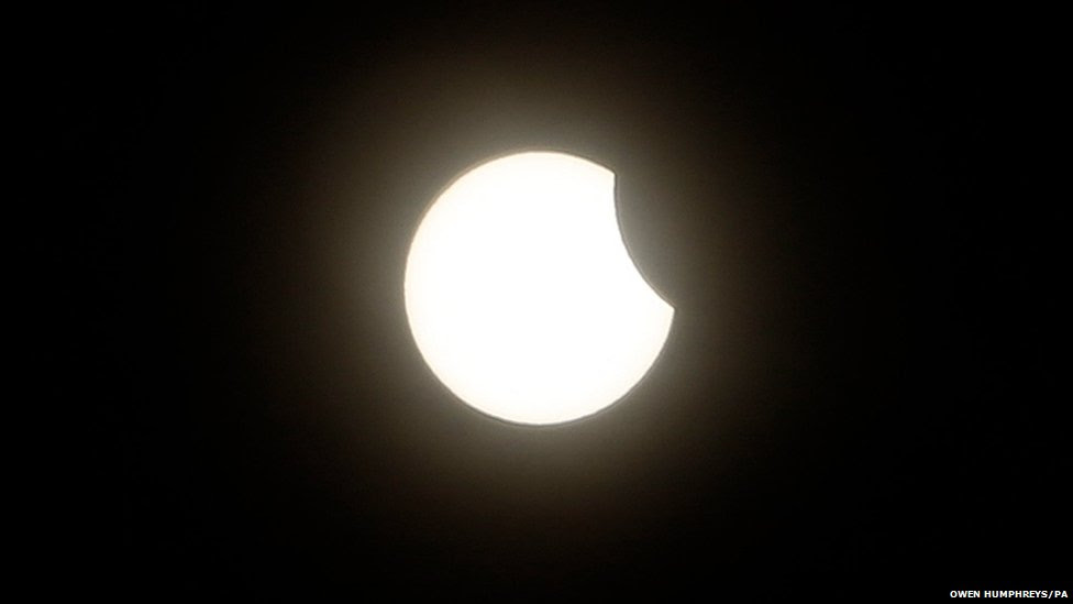 An eclipse of the sun begins over Plymouth in Devon