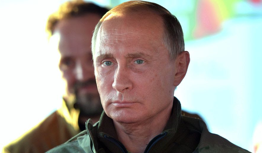 """Russian President Vladimir Putin's decree cited Washington's """"unfriendly actions"""" and the U.S. inability to fulfill its obligations under the 2000 deal as reasons for the move. (Associated Press)"""