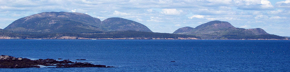Granite mountains on islands along coast