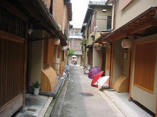 Geisha house and geisha in the tiny streets of Gion