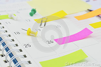 Post It notes with pin and clip on business diary page