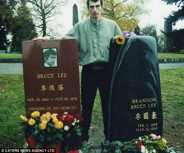 Mark with the grave of Bruce Lee Acclaimed martial artist, actor and icon buried with his son Brandon at Lake View cemetery