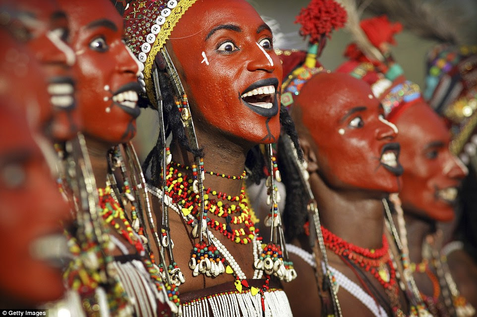 Culture: The Wodaabe believe bright eyes, white teeth and a sharp nose make a man beautiful - and the make up enhances these beatures