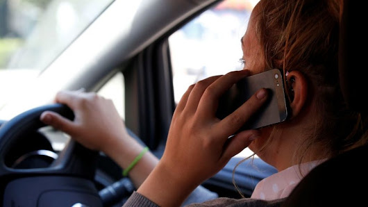 Thousands of drivers caught in mobile phone crackdown - BBC News