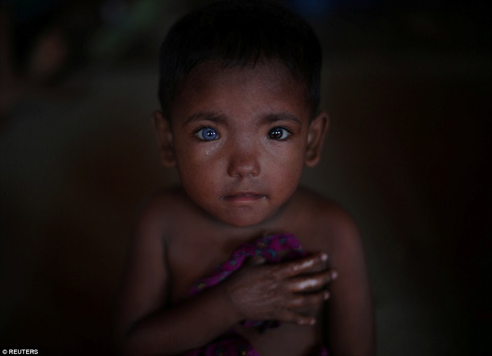 Hosne Ara, four, a Rohingya refugee who fled Myanmar in September listens to youngsters singing at a children's centre in the Kutupalong refugee camp near Cox's Bazar, Bangladesh, on November 5. About 600,000 Rohingya have fled Myanmar since August 25